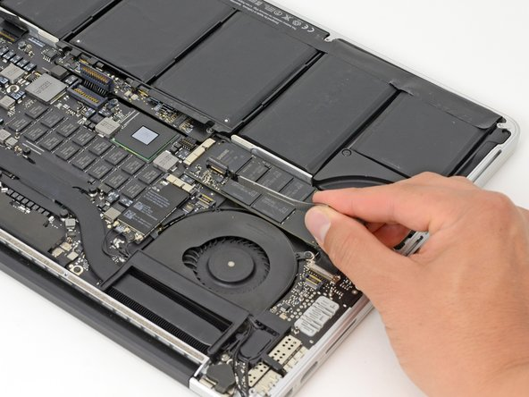 Remove the I/O board cable from the MacBook Pro.