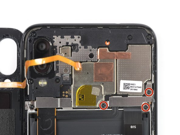 Use a Phillips screw driver to remove the three 3.3 mm-long screws securing the connector cover to the midframe.