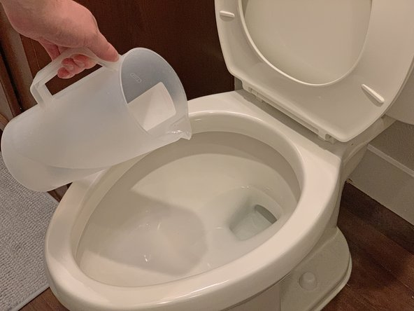 If need be, use a pitcher or a cup to add more water to the toilet bowl so that the water level is about half-way full.