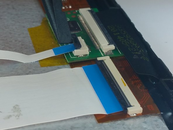 Use a spudger to lift up the black tabs on the three ZIF connectors.