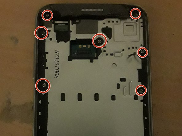 Take out all 11 screws noted by the red circles around them in both pictures with a #00 Philips head screwdriver. All these screws are the same size, so don't worry too much about where they all go. These are also the only screws in the phone.