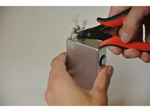 Using the wire cutters, cut cotton approximately ¼ of an inch away from outside of atomizer on each strand.