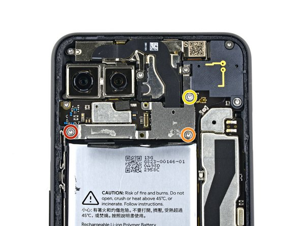 Remove the three T3 Torx screws securing the rear-facing camera connector cover: