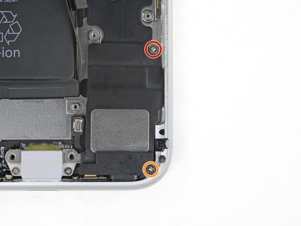 Remove the two screws securing the speaker to the rear case: