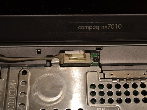 Remove a single screw and pry the connector for the screen from the motherboard.