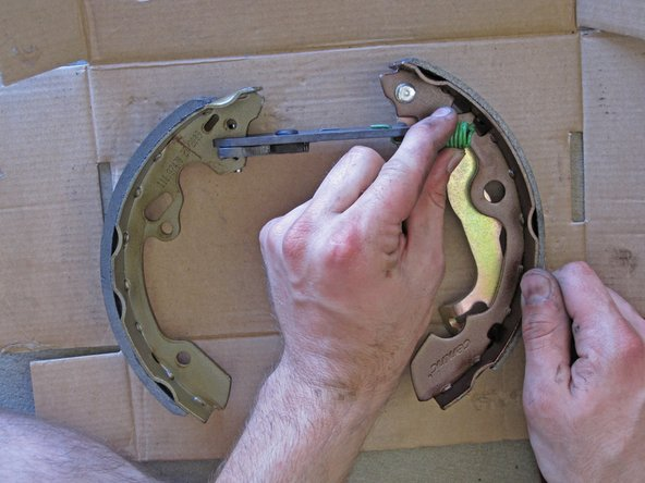 Reassemble the brake shoe assembly with your new brake shoes and hardware.
