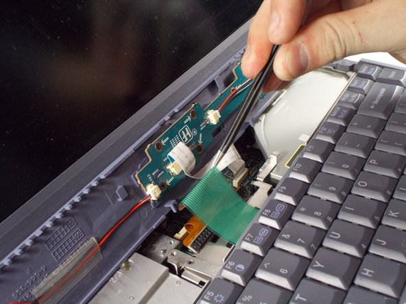 To unplug the ribbon cable, use a pair of tweezers to lift up the white bar near the connection to the motherboard. Only lift up the ribbon lightly to release ribbon from the motherboard.