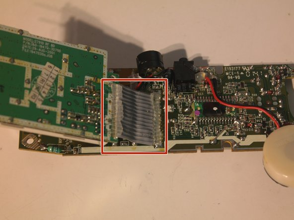 The wireless board is attached by a soldered and hot-glued in ribbon cable, which must be cut off to remove.