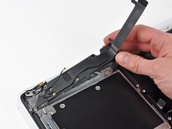 Remove the rear speaker assembly from your MacBook.