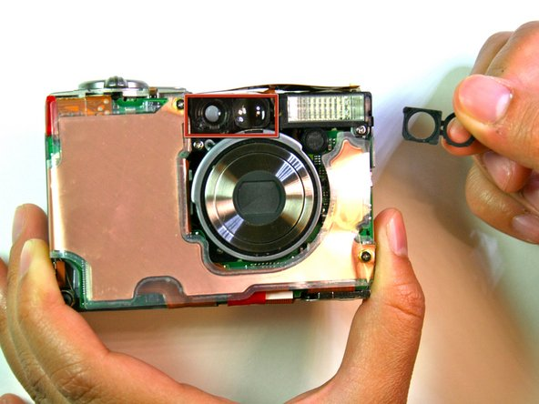 Remove the rubber seal that covers the right side of the viewfinder.