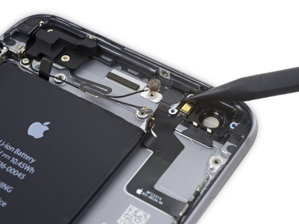 Use the pointed end of a spudger to lift the flash out of its housing in the rear case.