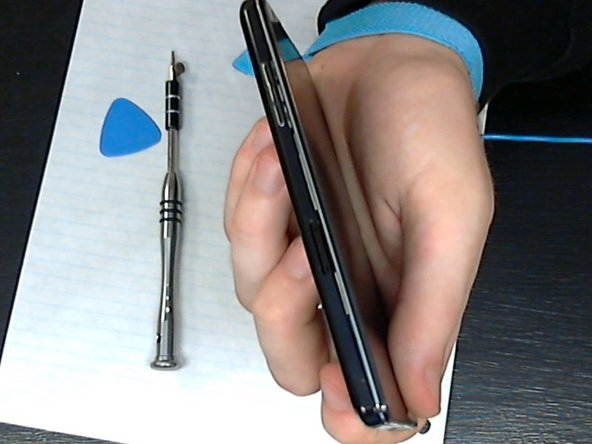 Once you get the side done, start on the bottom of the phone (around the charging port)