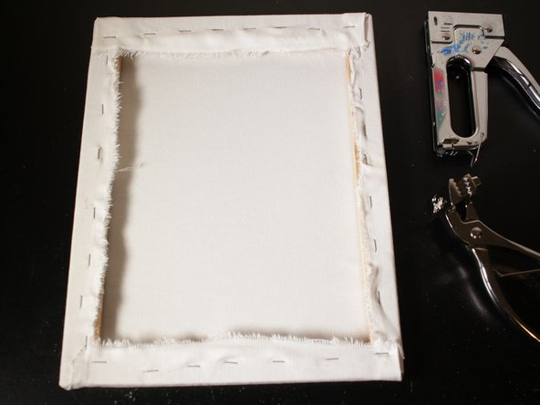 When you are finished, stretched canvas should be tight and it should sound like a drum when you tap on it.