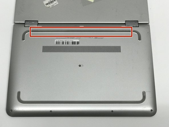 Remove the rubber grip using a plastic opening tool.