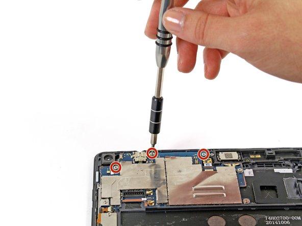 Remove the three 3 mm T5 Torx screws.
