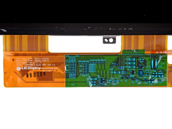 The label on the display ribbon cables and on the back of the display indicate that it was manufactured by LG.