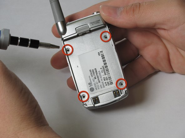 Use the T7 Torx screwdriver to remove the four screws that are in the cavity where the battery was.