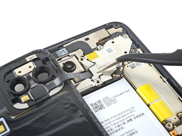 Use a pair of tweezers to remove the back panel connector cover.