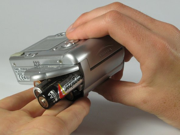 Remove the 4 AA batteries.