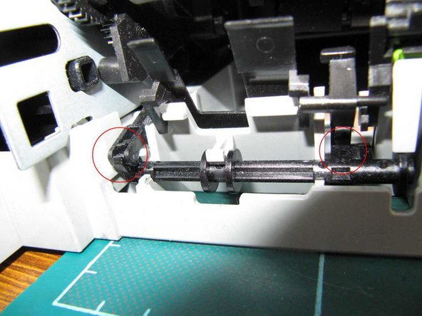 The entire print mechanism can be removed from the base. First, release a lever at the left hand side of the back of the printer from its clip on a spindle. You may have to gently press on a tab near the other end of the spindle in order to bring the clip forwards so as to be able to release the lever.