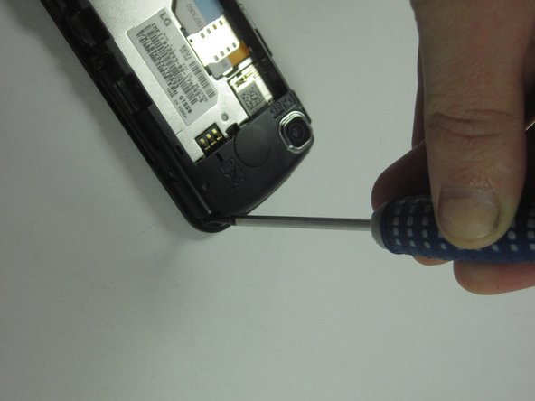 Remove the six screws around the outside of the phone using a Phillips #0 screwdriver.