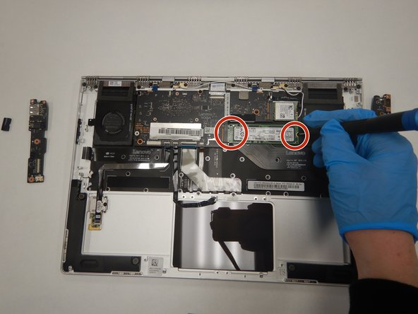 Remove all 4 screws attached to SSD stick with a small Phillips head screwdriver.