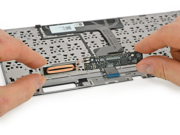 Dispatching the keyboard and sensor cable, we pop the main board—and attached inductive charging coil—from the keyboard.