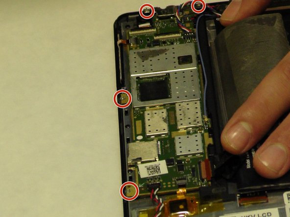 Use a JIS screw bit #00 to remove screws around the motherboard using the provided image to locate each screw.