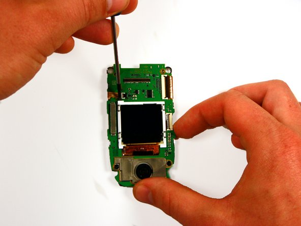 Using a small Phillips screwdriver, gently pry off the LCD screen from the board.