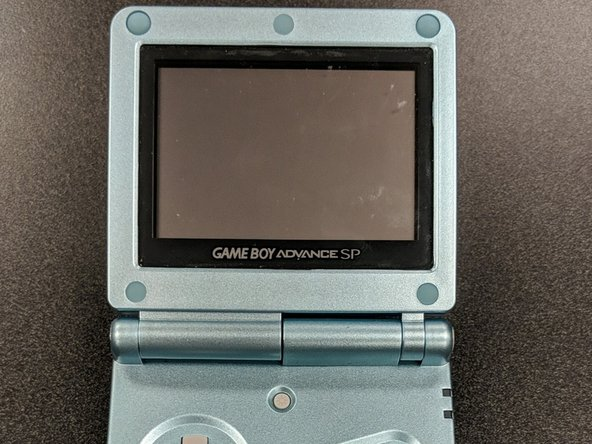 Reinstall the rubber pads around the screen bezel—they stop the shell from rubbing together on the inside.