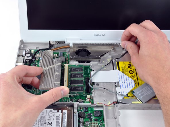 It may be necessary to soften the thermal paste between the logic board and heat sink. You can soften the thermal compound using a hairdryer. Move the hairdryer back and forth over the ribbed metal section of the heat sink. At this point, the heat sink should come free easily.