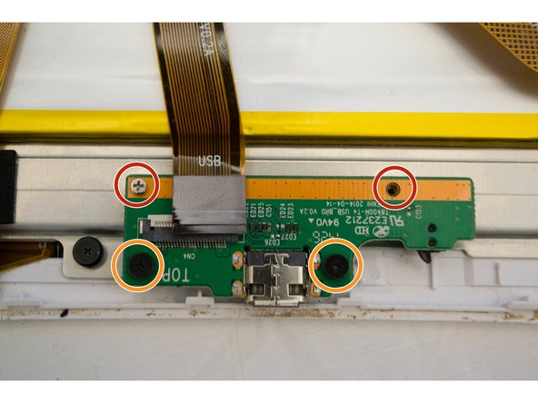 Remove four screws from the charging connector.