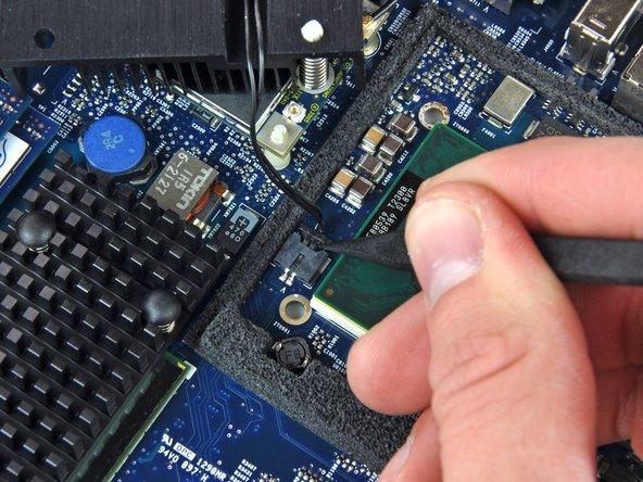 Use the tip of a spudger to push the heat sink thermal sensor connector out of its socket.