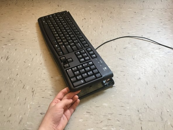 Remove the top of the keyboard and put it aside.