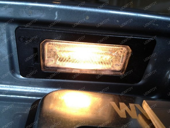 Get a Philips screwdriver and remove the screws from the license plate lamps.