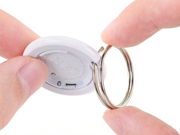 Insert your keyring through the keyring hole.