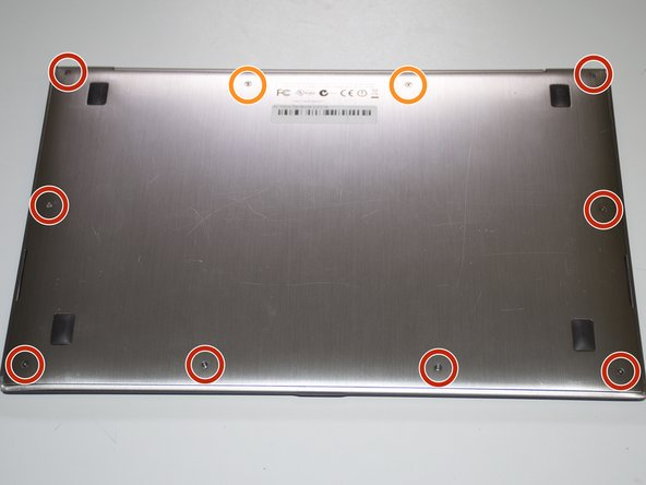Using a T4 Torx screwdriver, unscrew the ten screws lining the bottom cover. Then, proceed to remove the bottom cover by sliding it out parallel toward  the back of the computer.