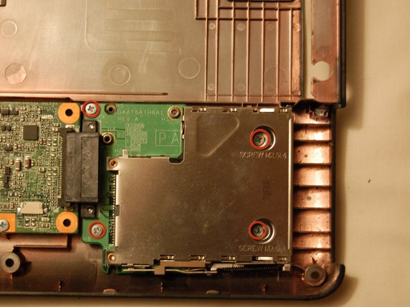 Remove these four screws, and pull the express card module away from the motherboard.