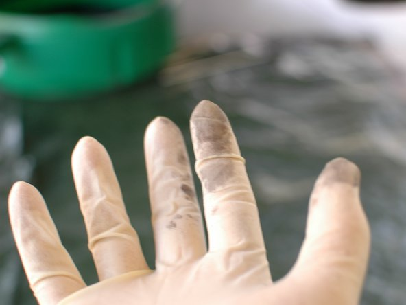 Wearing gloves during an oil change is a very good idea. As mentioned before, it stains everything. As you can see, even after wiping up, these latex gloves are stained. Imagine what it would do to your skin.