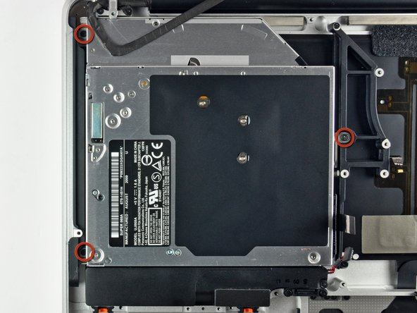 Remove three 3.5 mm Phillips screws securing the optical drive to the upper case.