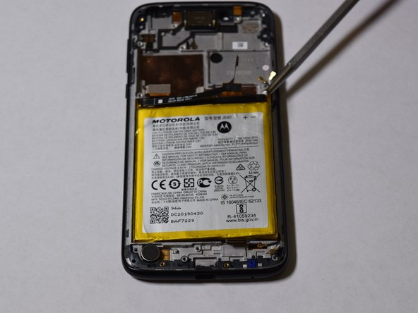 Pry the battery up now that the adhesive has been separated from the battery.