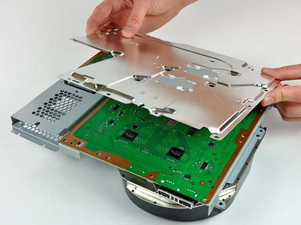 Separating the metal electromagnetic interference shield from the logic board.