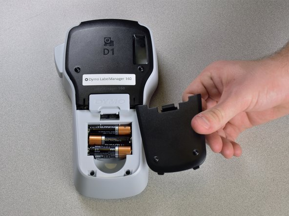Remove the compartment cover to reveal the batteries. Remove the 6 old batteries.