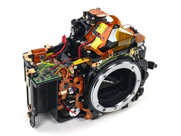 At this point we'd like to stop and let you appreciate the space management that goes into designing a DSLR camera. Wires and ribbon cables run amuck, yet everything works together in perfect harmony, allowing you to express your artistic vision with the press of a button.