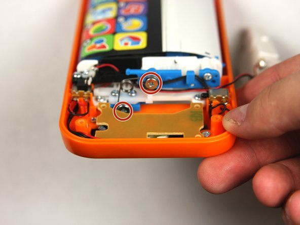 Remove two 7.2 mm screws with a Phillips #0 screwdriver.