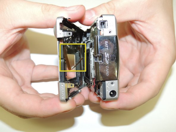 Then, carefully pry apart the front and back outer casing away from the internal components.