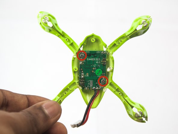 Use the PH000 driver to remove the two screws securing the flight controller to the frame.