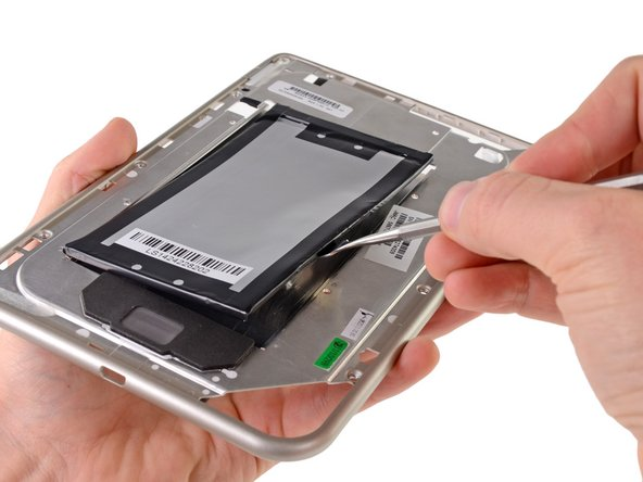 A pair of adhesive strips refuse to let the battery go. Fortunately, we at iFixit are masters of removal.