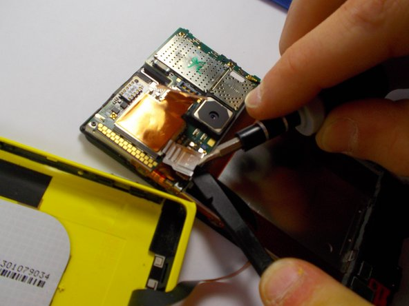 This step may be easier to remove the battery first, but it is not mandatory.