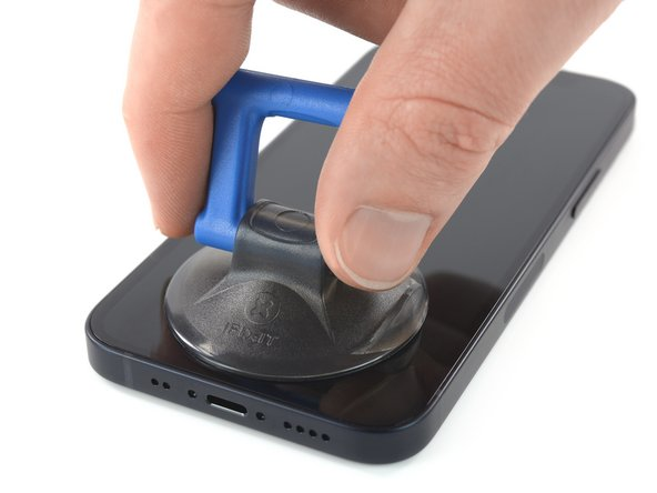 If you're using a single suction handle, apply it to the bottom edge of the phone, as close to the edge as possible.